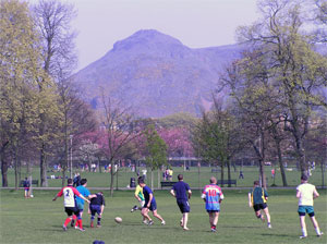 Playing on the meadows, with a view to Arthur's Seat